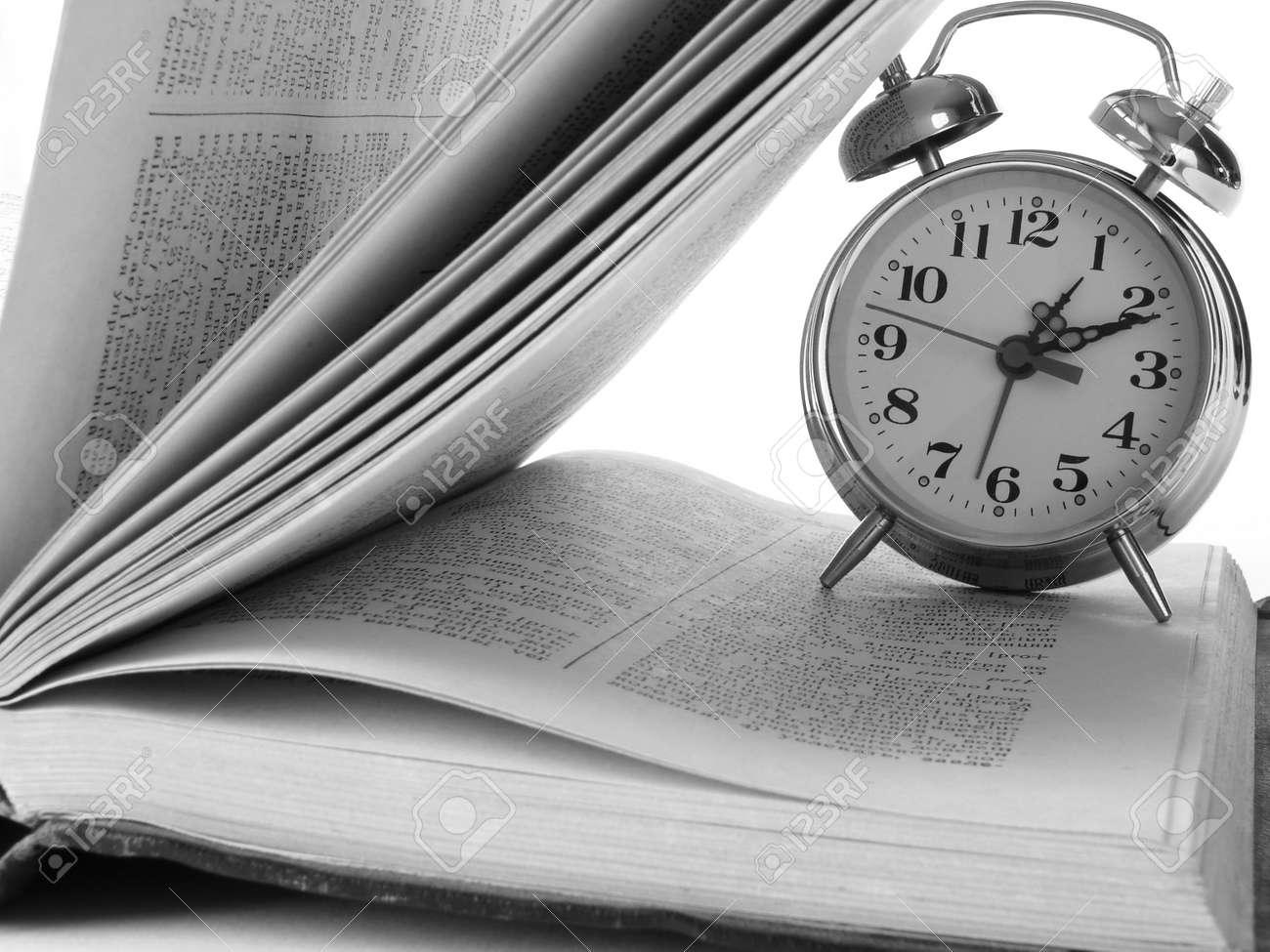 open book and classic alarm clock Stock Photo - 2169068