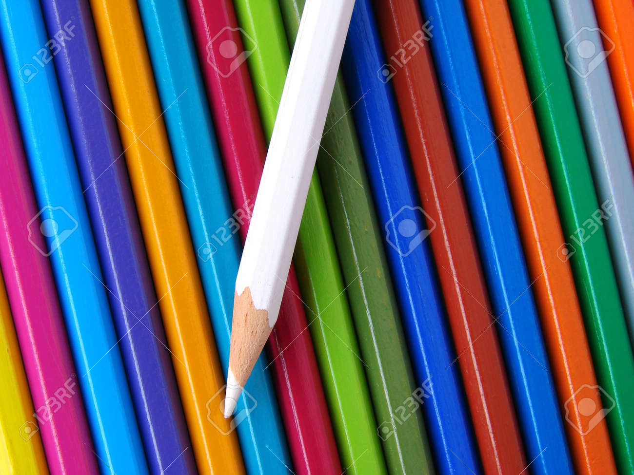 white pencil against colorful ones set background Stock Photo - 4178538