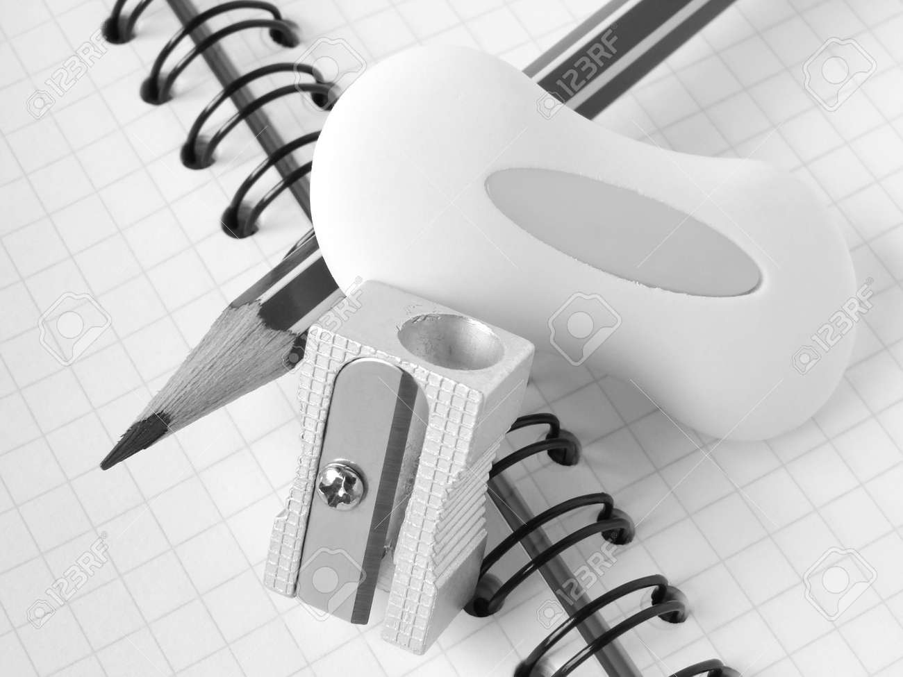 sharpener and pencil with eraser on the spiral notepad page Stock Photo - 5542771