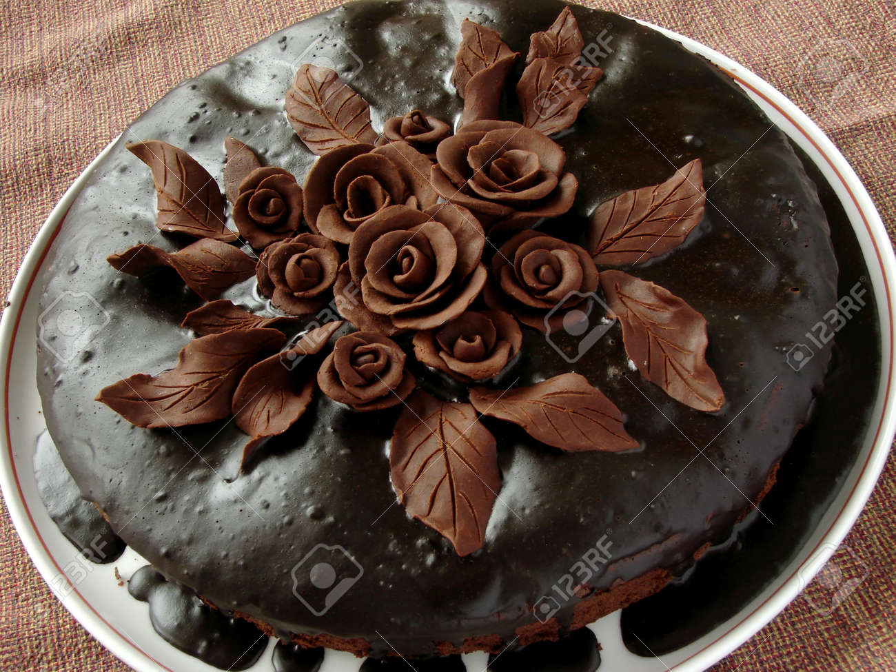 Homemade Glazed Cake Decorated With Chocolate Roses And Leaves ...