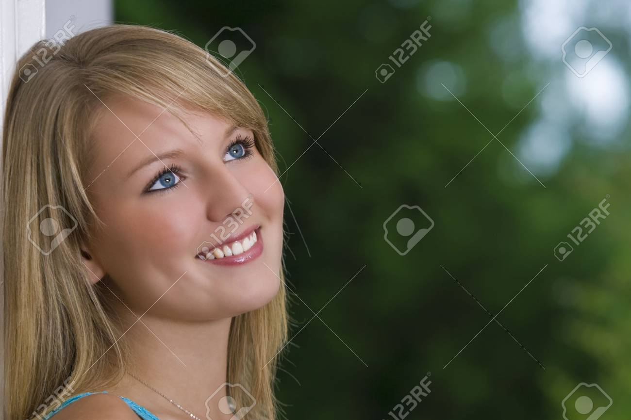 A naturally pretty young woman looking happy Stock Photo - 2083938