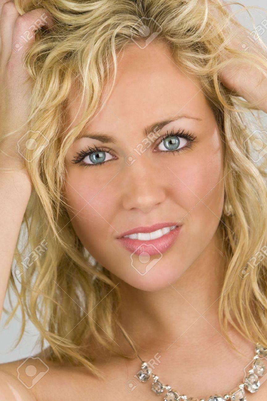 Studio shot of a stunningl beautiful blue eyed model running her fingers through her blond hair Stock Photo - 2223286