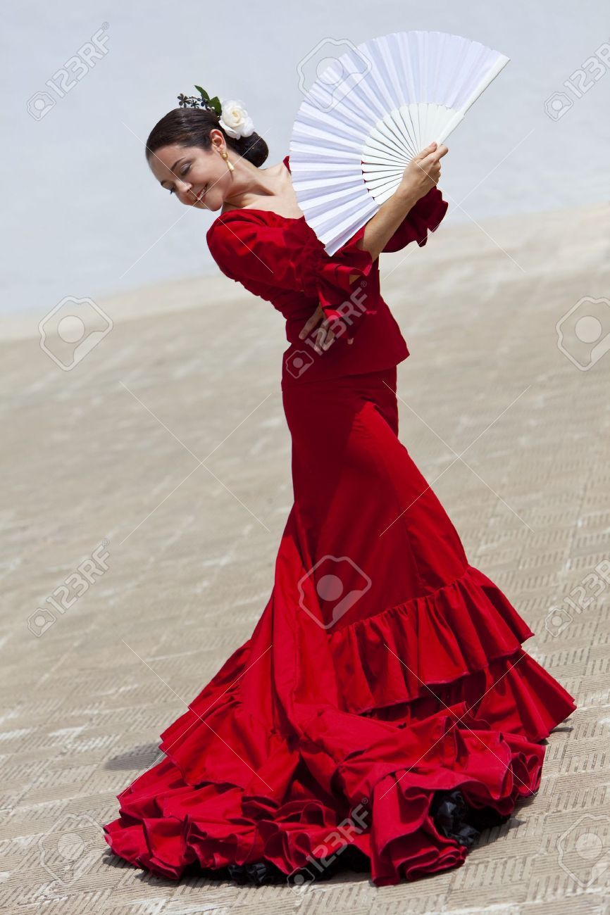 Woman traditional Spanish Flamenco dancer dancing in a red dress with a white fan Stock Photo - 7167774