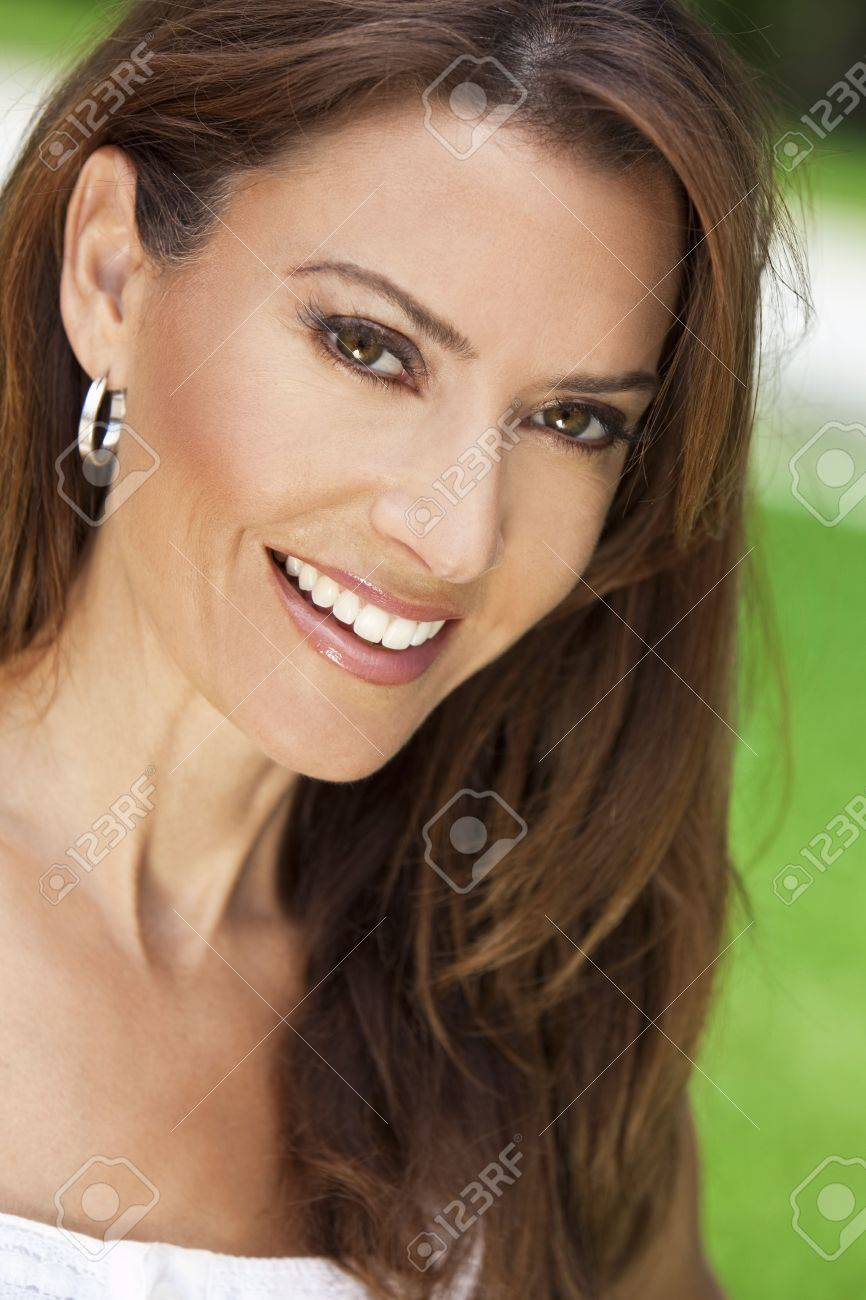 Outdoor portrait of a beautiful young brunette woman in her thirties Stock Photo - 7256450