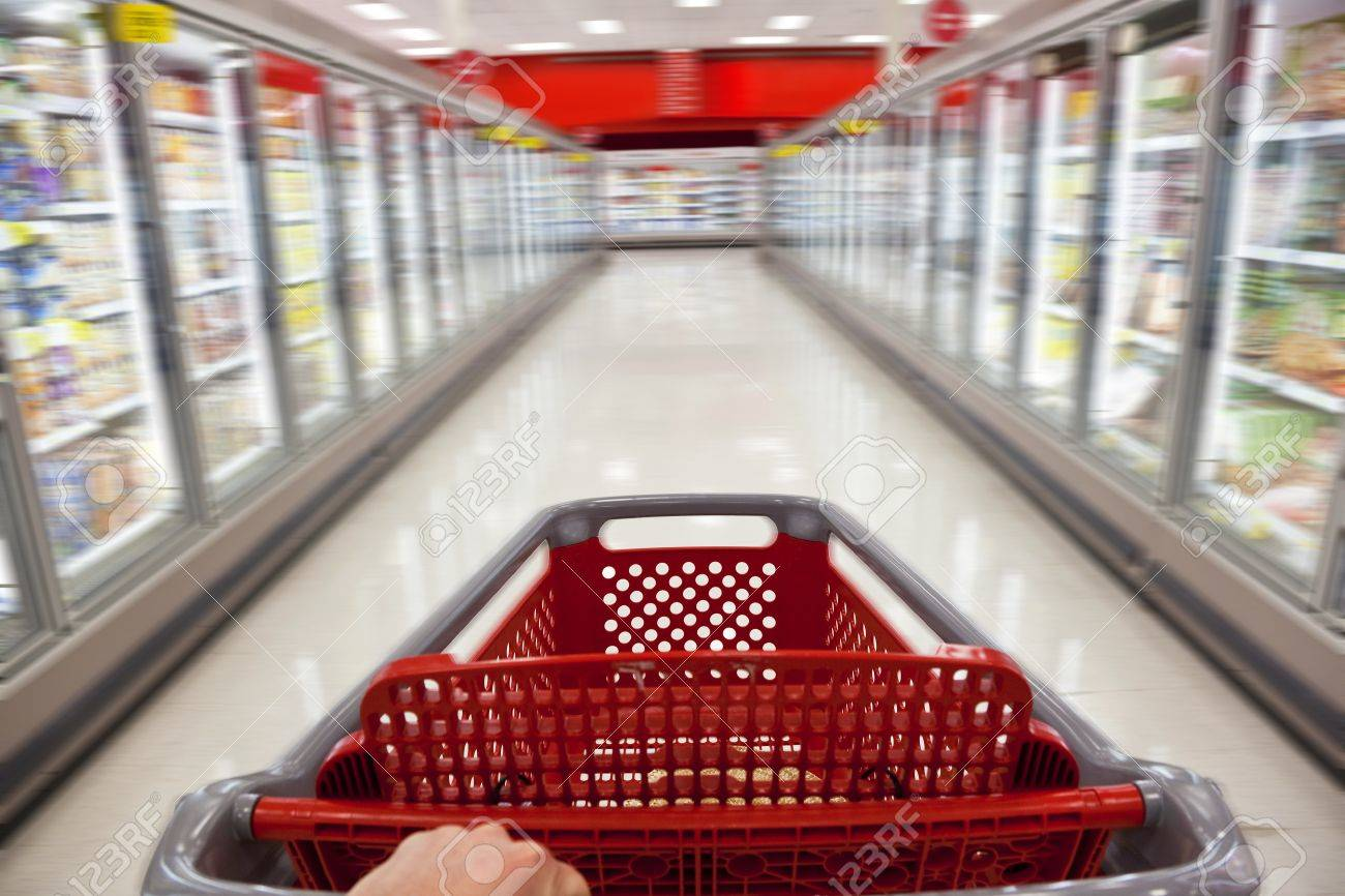 A fast food concept motion blur shot of a shopping trolley being pushed down the aisle of a supermarket Stock Photo - 8710098