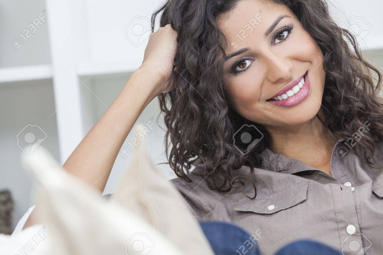 Studio portrait of a beautiful young Latina Hispanic woman smiling Stock Photo - 16782650