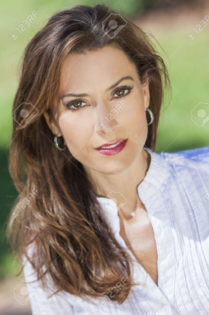 Outdoor portrait of a beautiful young brunette woman in her thirties Stock Photo - 17329939