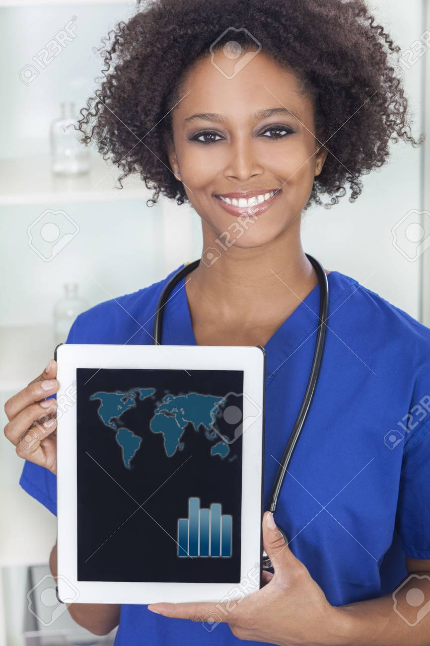 An African American female woman medical doctor holding a tablet computer in hospital with a world map and graph graphics on the screen Stock Photo - 17329571