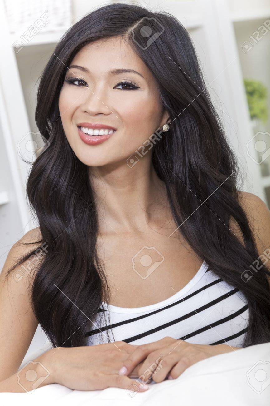 A beautiful young Chinese Asian Oriental woman with a wonderful toothy smile Stock Photo - 17475674