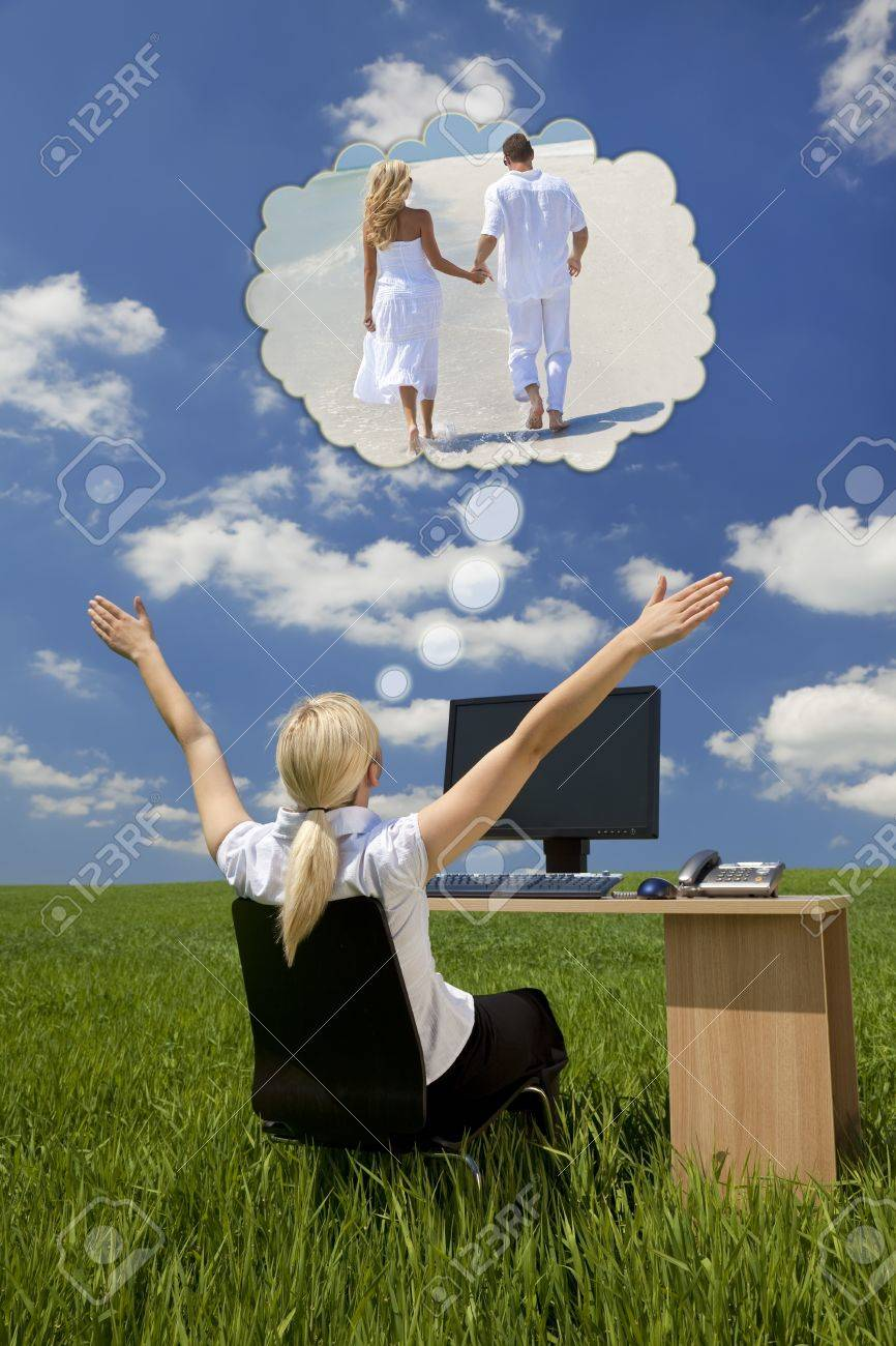 Business concept shot of a beautiful young woman sitting at a desk using a computer in a green field raising her arms into the sky daydreaming of being on a tropical beach with her husband or boyfriend Stock Photo - 19285164