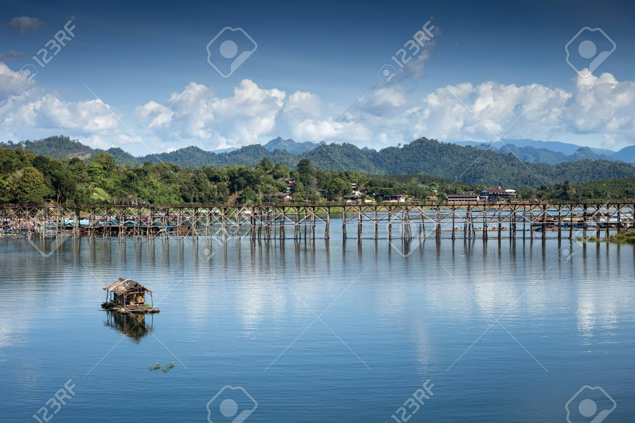 landscape view of great lagoon with a wooden bridge with a small raft on a great lagoon. - 67416489
