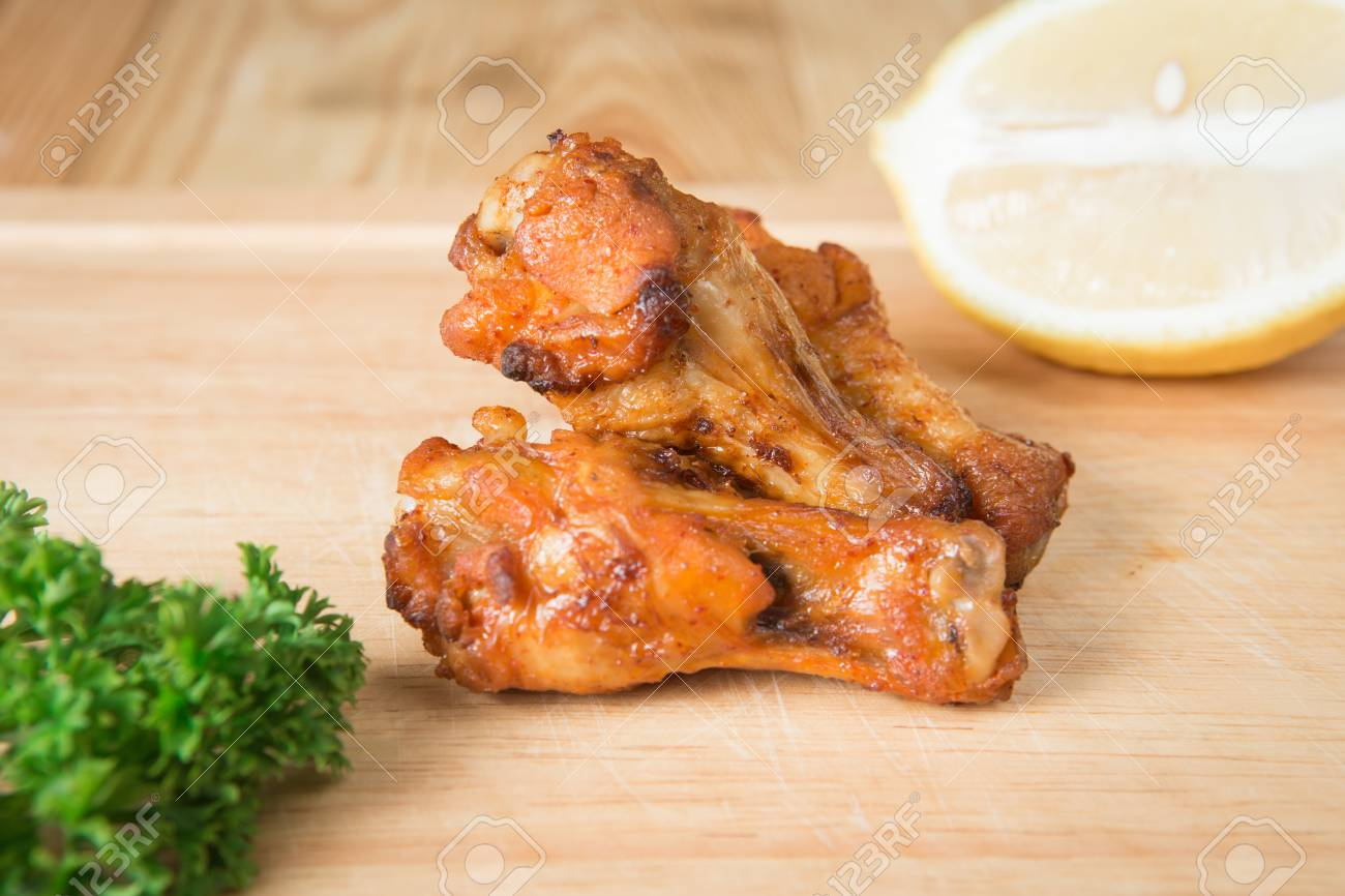 Grilled chicken wing on a wooden block.(Selective focus) - 71330566