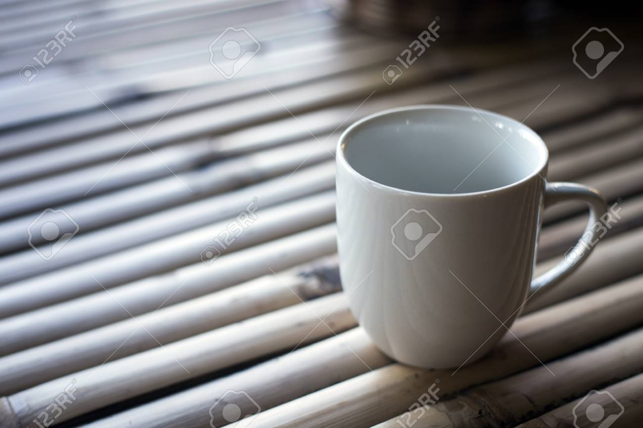 White cup on a wooden background - 72873778