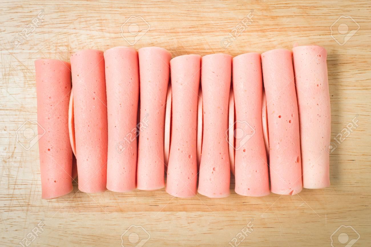 rolled ham arrange on wood block - 77532156