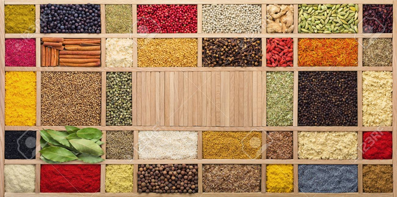 Spices and herbs in wooden box, top view. Seasonings from all over the world for cooking food. - 107310108