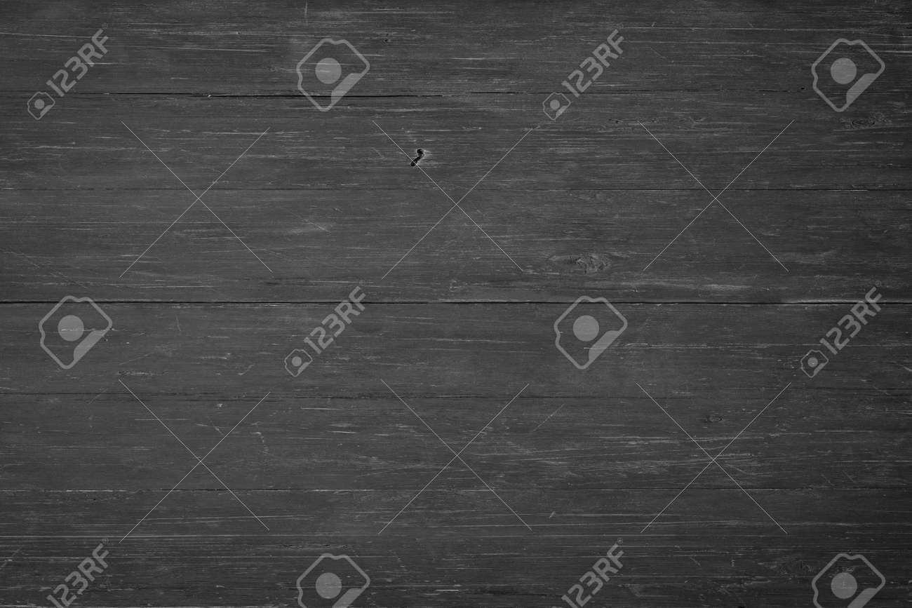 dark wood texture, top view. black wall boards as background - 172598773
