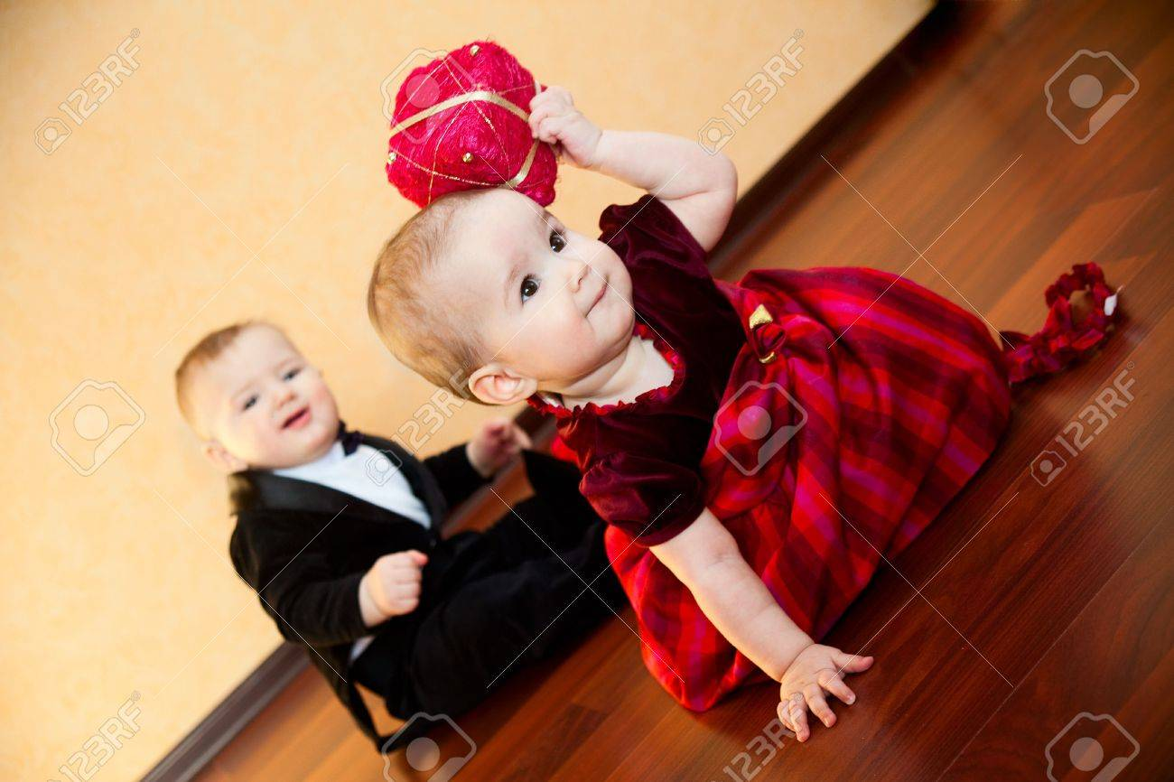 baby boy and baby girl playing together Stock Photo - 4796310