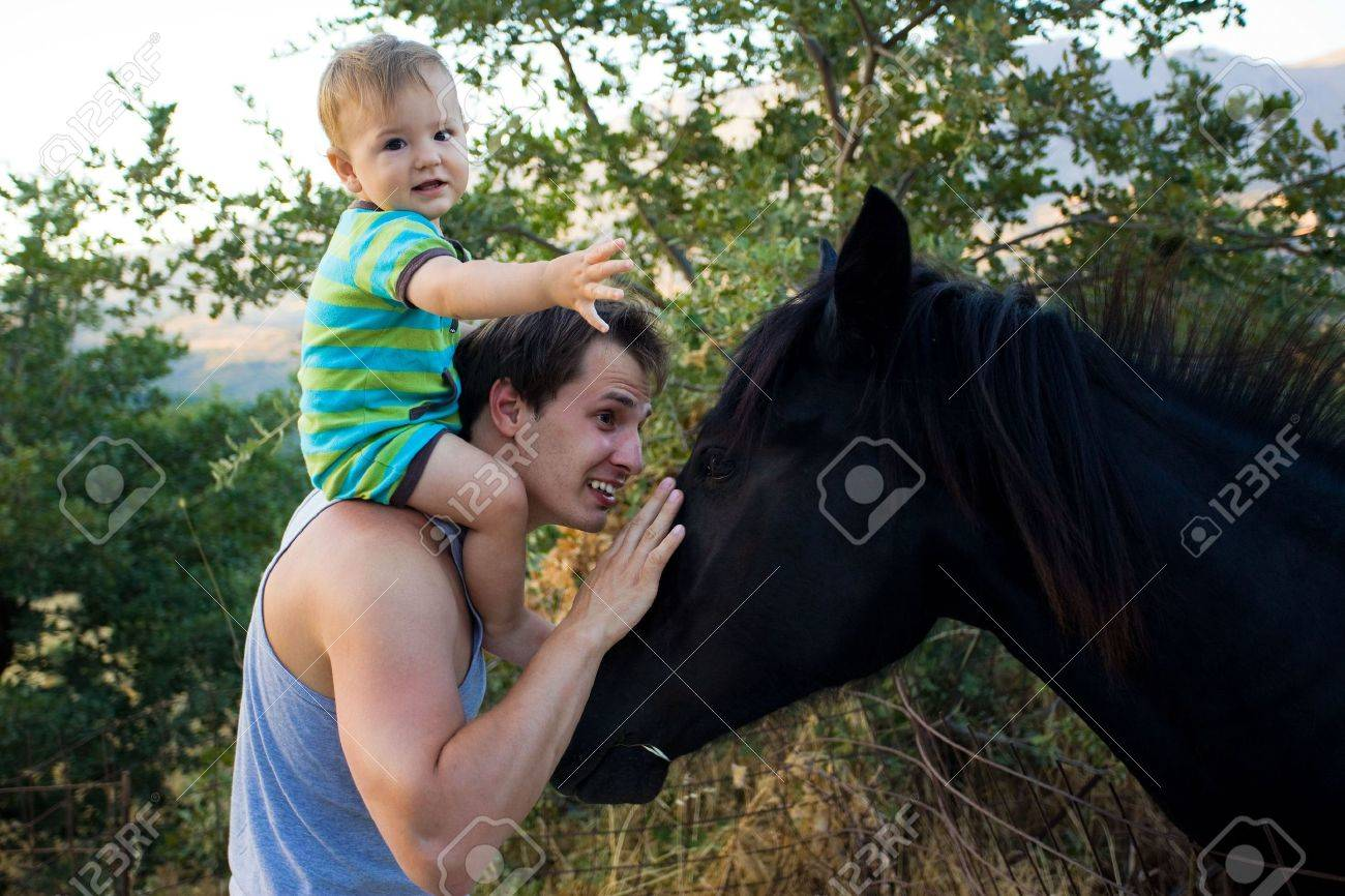 Dad And Baby Son Stroking Brautiful Black Horse Stock Photo Picture And Royalty Free Image Image 5305432