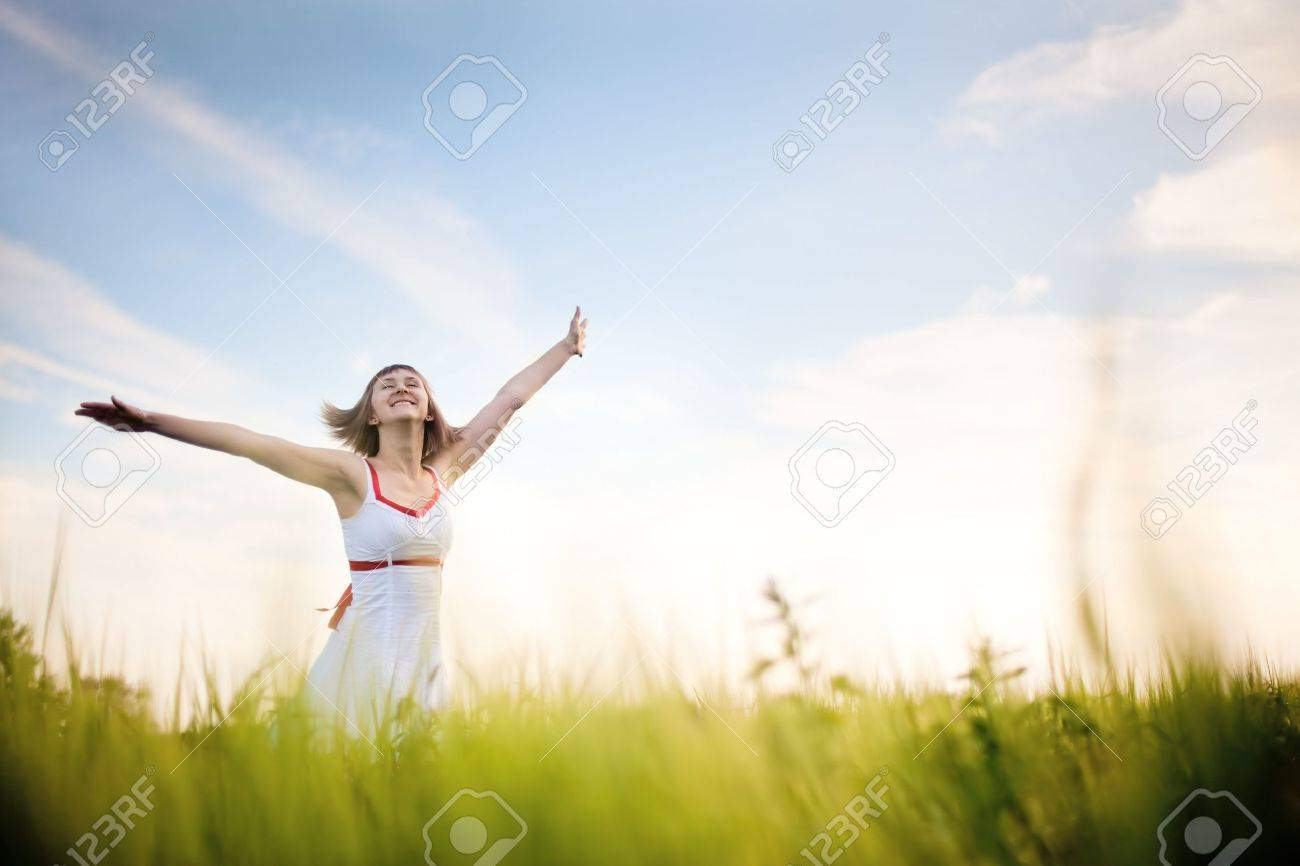 happy young woman enjoying nature Stock Photo - 7755519
