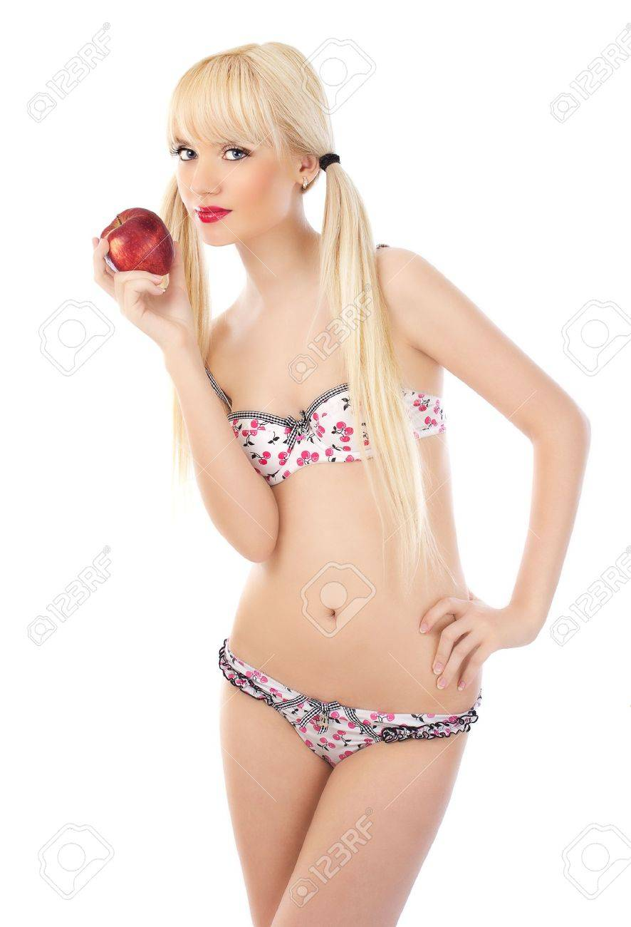 Seductive blonde woman in lingerie holding red apple on white background Stock Photo - 14745500