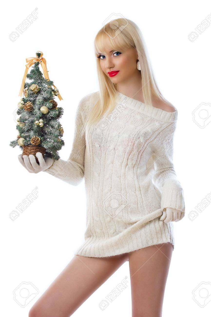 Beautiful young blonde woman holding small christmas tree on white background Stock Photo - 16551595