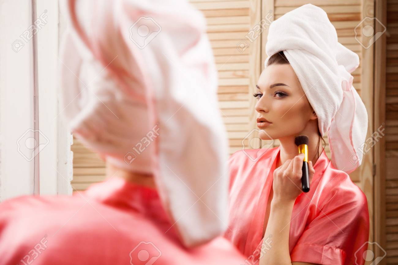 Girl In The Spa Doing Makeup In Front Of The Mirror Stock Photo