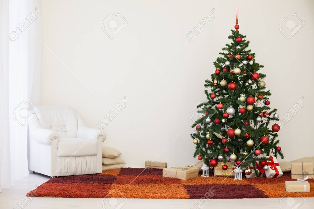 Christmas Tree In The White Room Of House For With Gifts Stock Photo