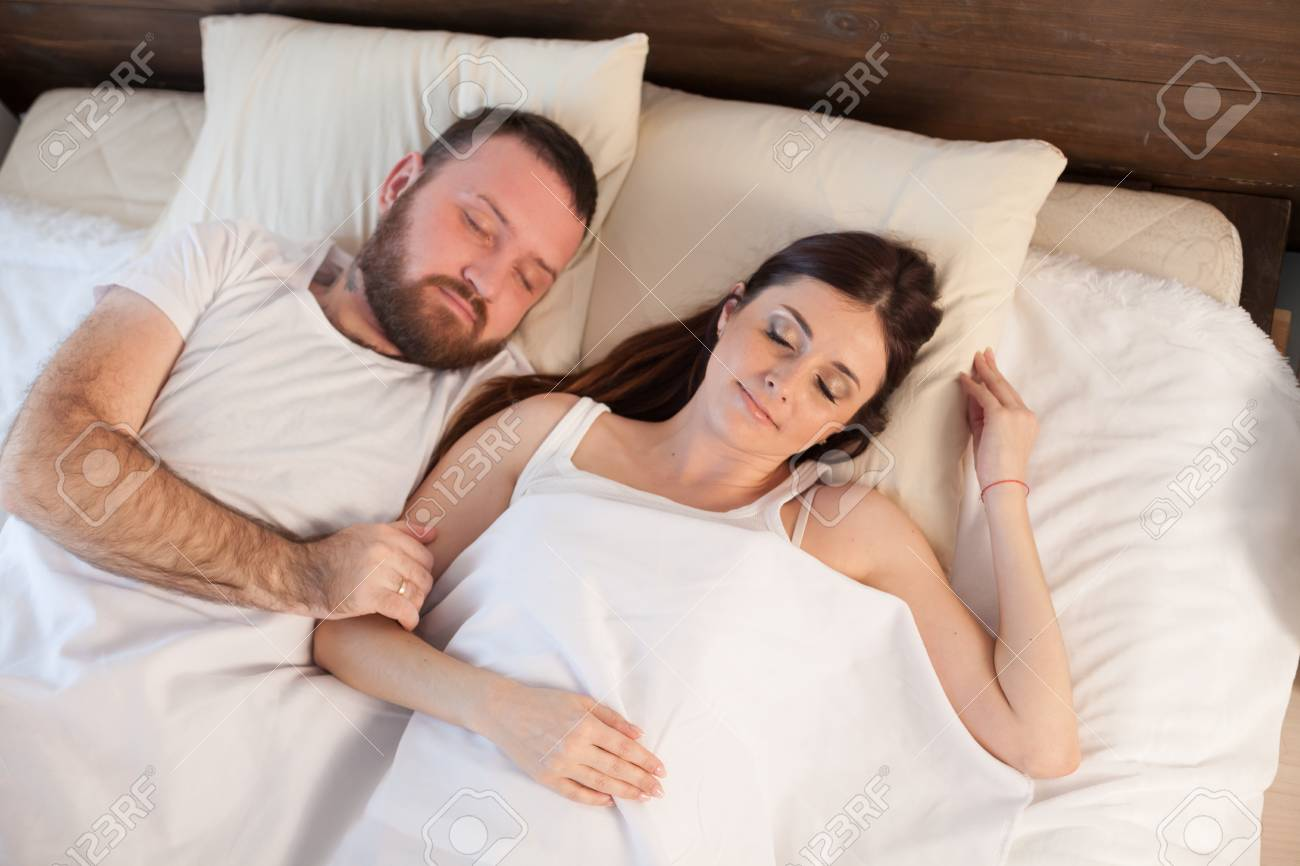 a man sleeping with a woman