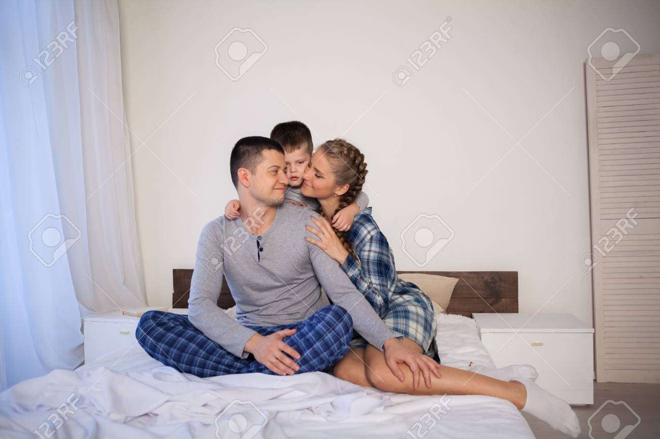 The family morning in the bedroom on the bed mom dad son stock photo 113719660