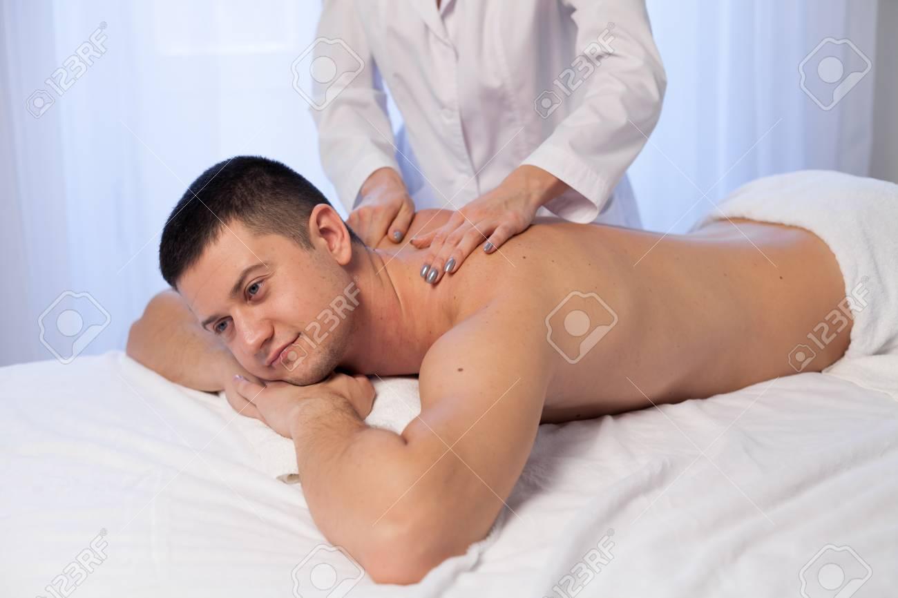 male massage therapist make therapeutic massage and body therapy..