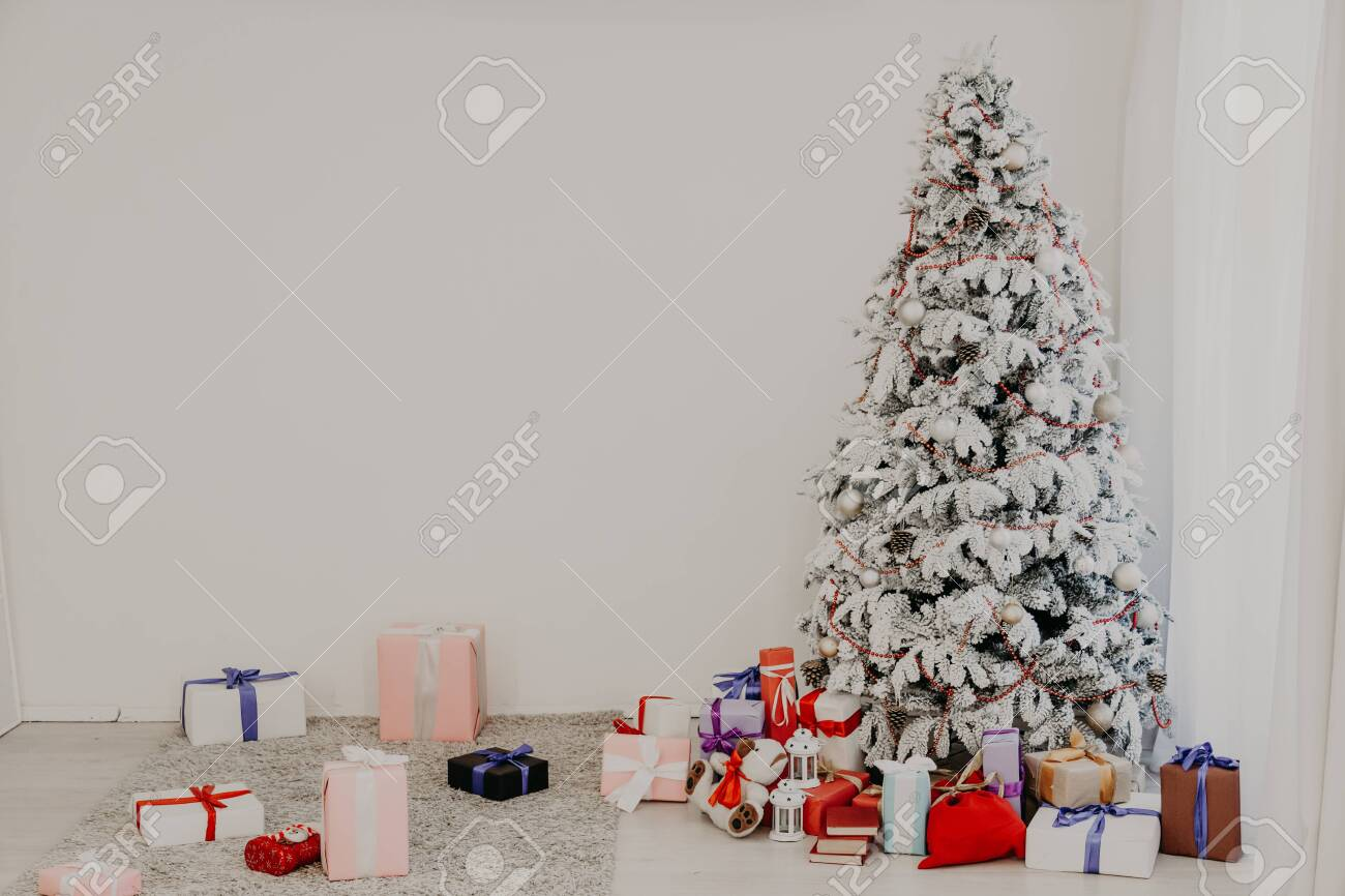 christmas tree with presents garland lights new year 2020 stock photo picture and royalty free image image 132611931 christmas tree with presents garland lights new year 2020