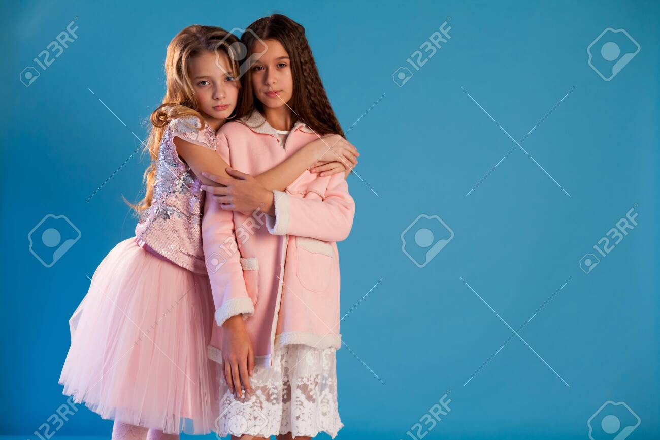 Two beautiful fashionable girl girlfriends in pink and white dresses - 133286770