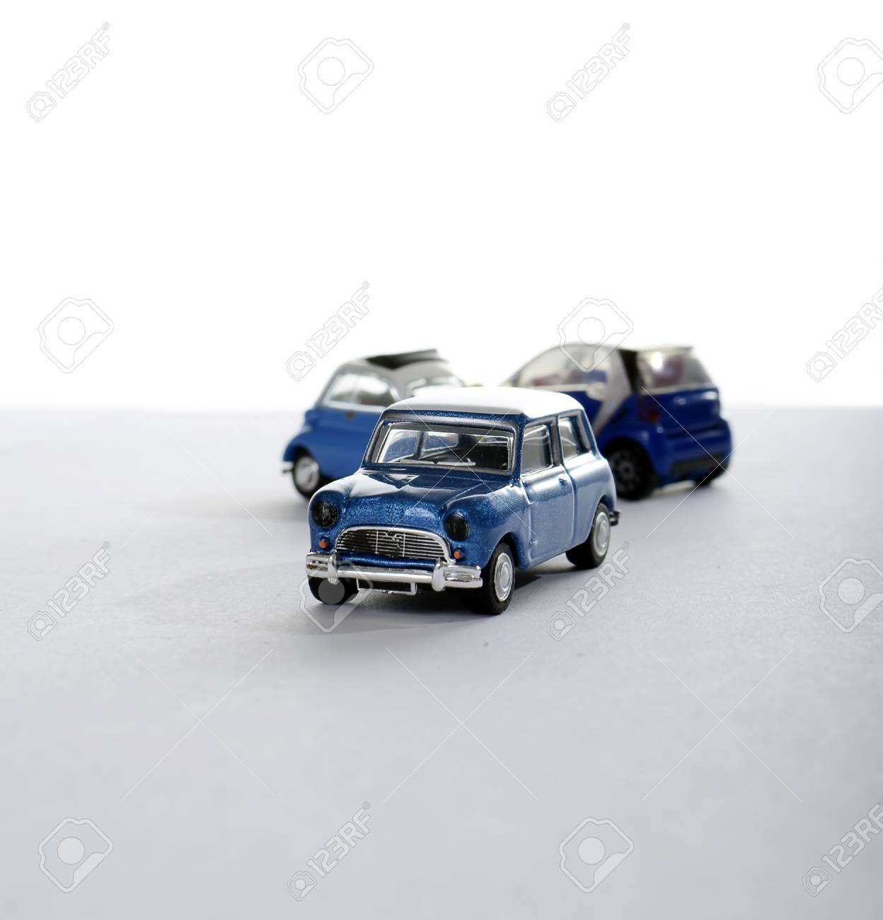 miniature car against other cars, concept Stock Photo - 11170511