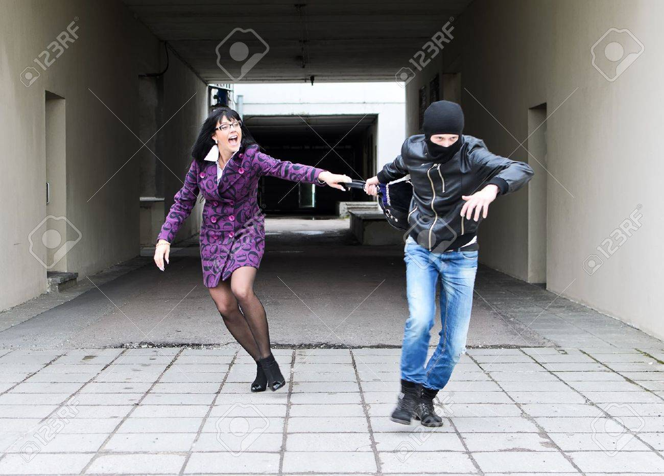 Daylight robbery on the street. Thief steals a bag. Stock Photo - 13559102