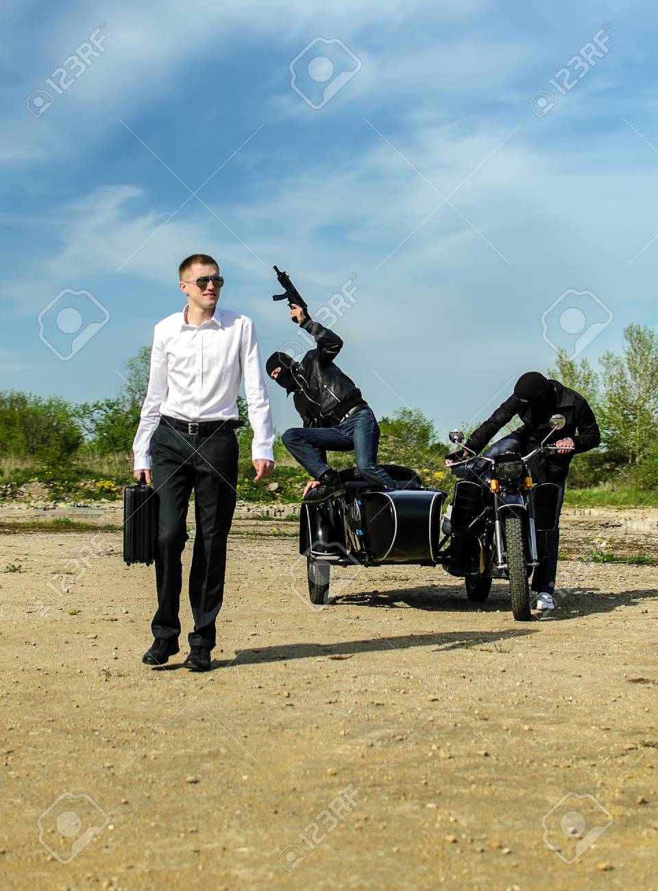 Two bandits kidnapped a businessman with a suitcase Stock Photo - 13758849