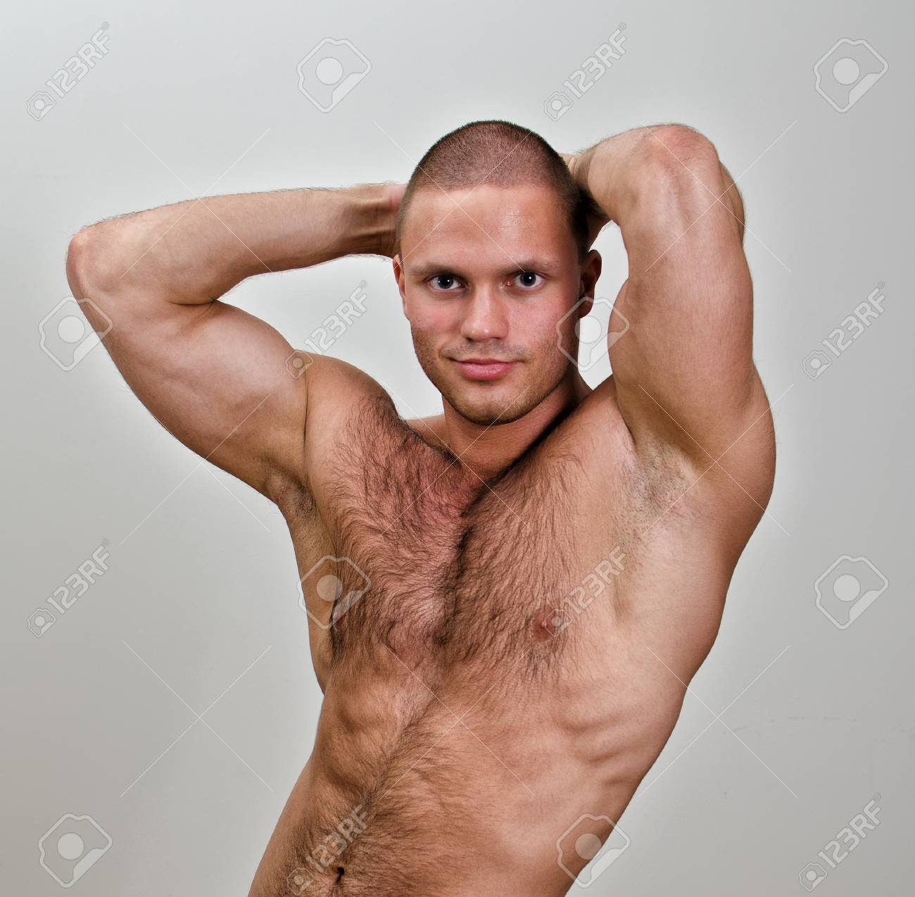 Muscular bodybuilder torso. On grey background. Stock Photo - 14265335