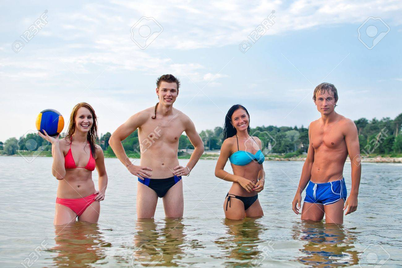 Young people posing in the sea Stock Photo - 14716277