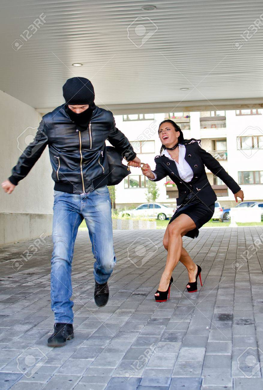 Bandit stealing businesswoman bag in the street Stock Photo - 14902676