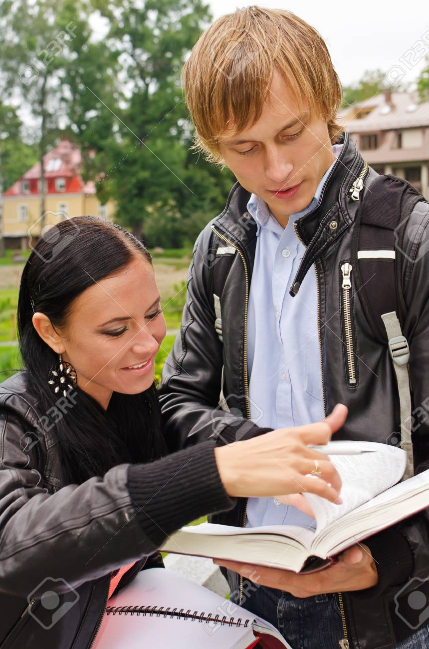 Two students studying outdoors Stock Photo - 15148613