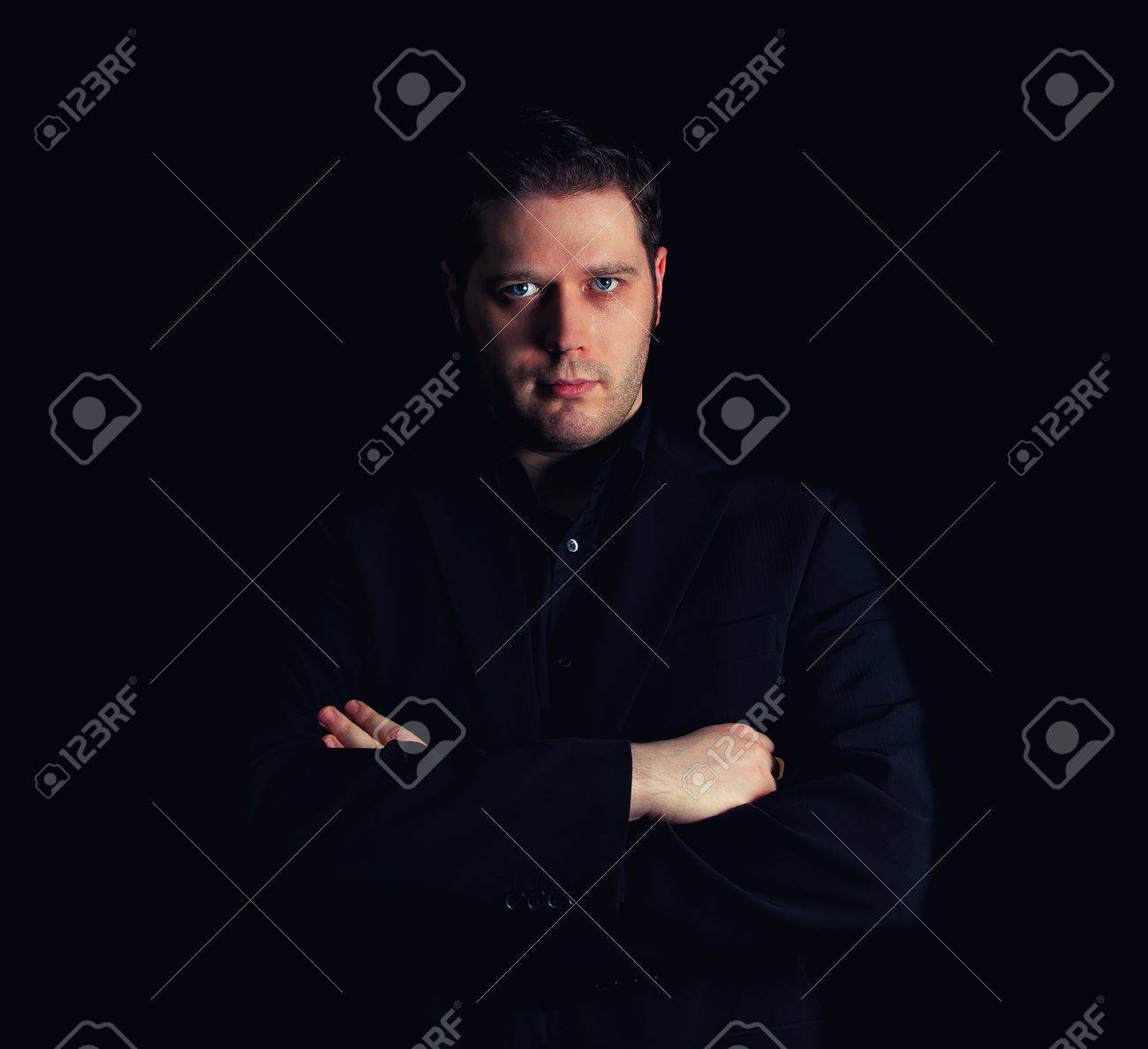 Portrait of man in black suit with crossed arms Stock Photo - 16763512