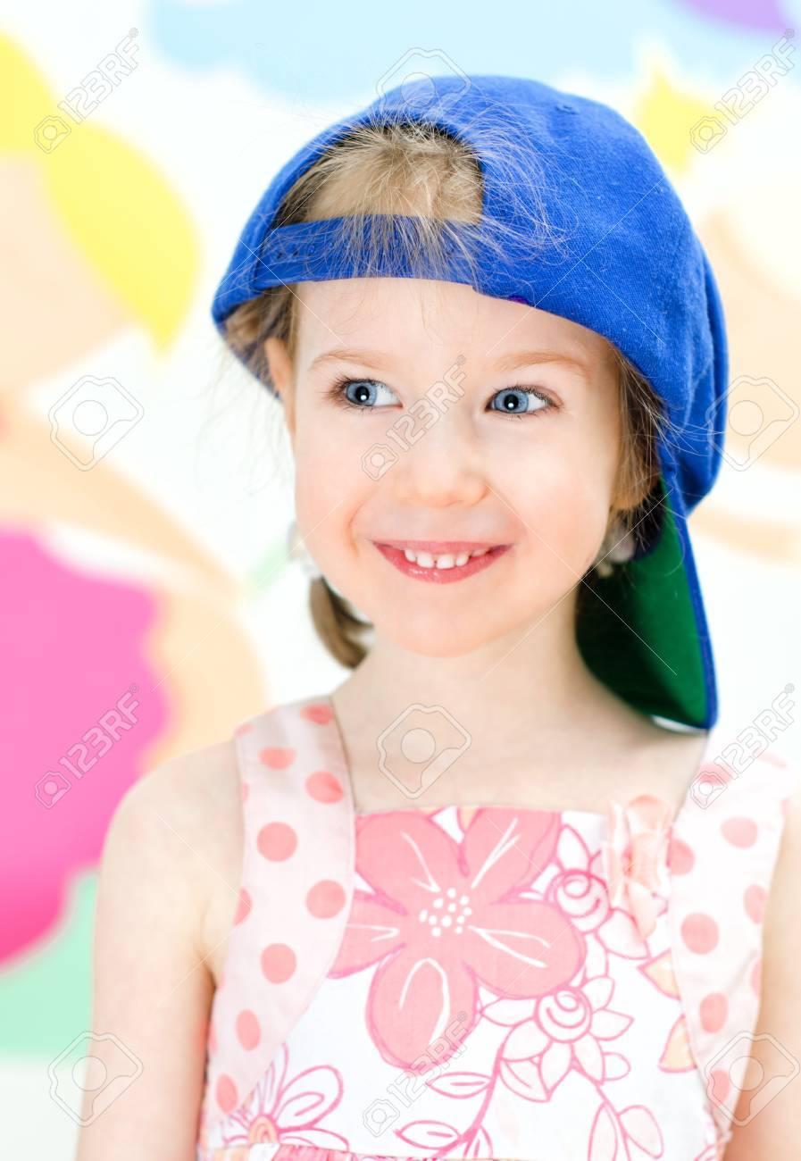Cute little girl in a baseball cap Stock Photo - 18916164 f4d90b16574