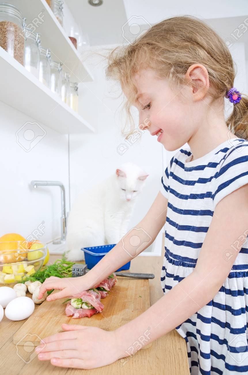Little Girl Making Meatloaf In The Kitchen. Stock Photo, Picture And ...