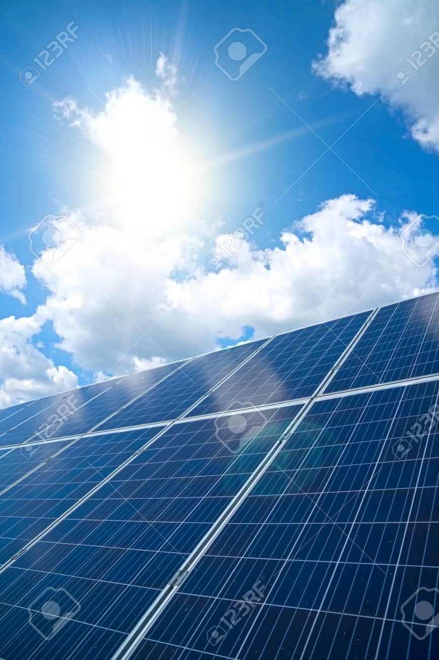 Blue solar panels over blue sky. Renewable energy. - 108423212