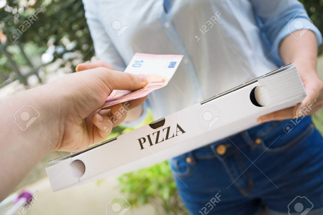 Woman delivering pizza in box and taking payment. - 109613957