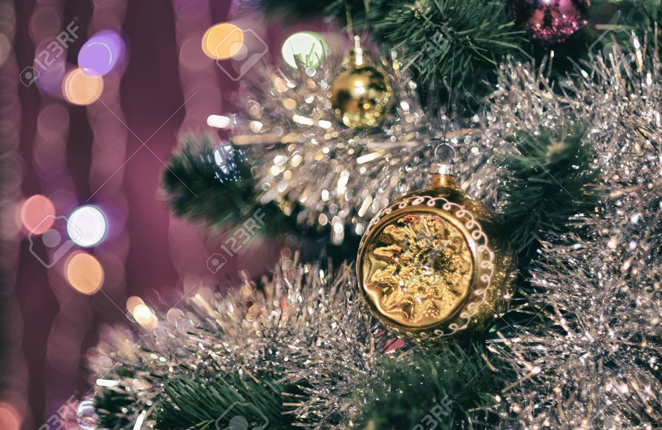 Unusual Hemisphere On A Christmas Tree In Shiny Tinsel Garland