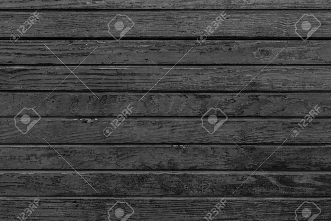 Horizontal black wood background. Old dark wooden background with black wood texture. Dark wood texture panel with horizontal planks. - 169877489