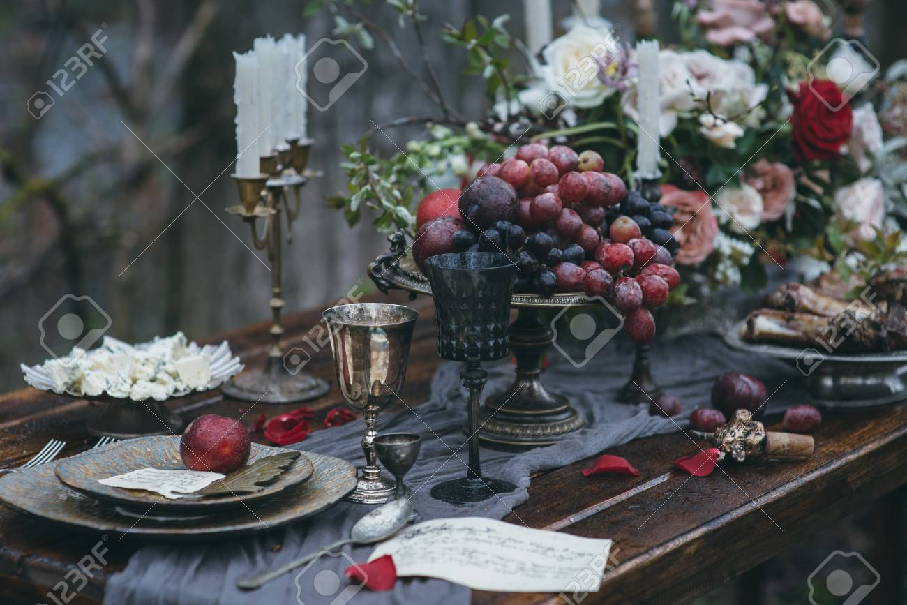 Wedding decoration on nature table with meat flowers and candles stock photo wedding decoration on nature table with meat flowers and candles junglespirit Gallery