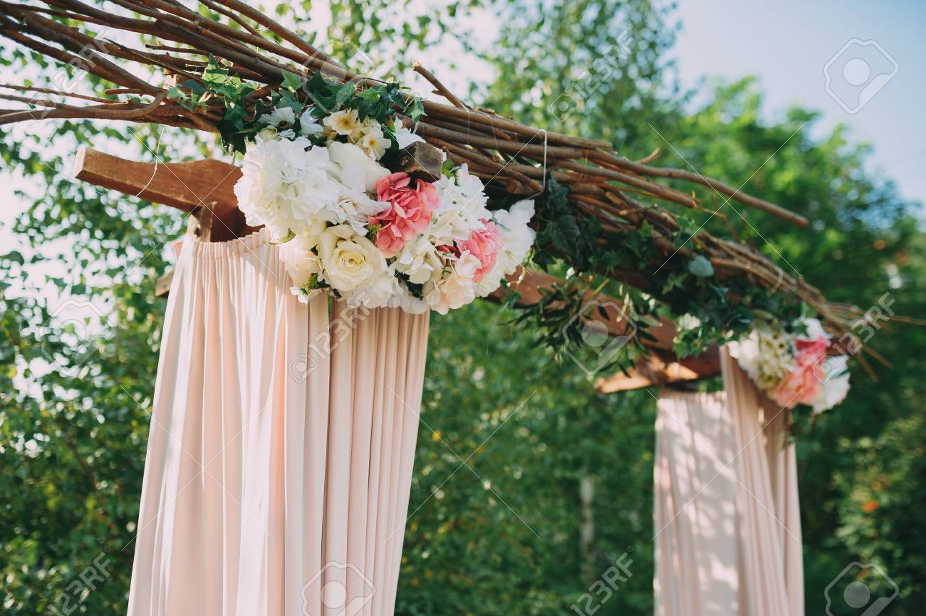 Beautiful Wedding Ceremony Outdoors Arch Made Of Natural Flowers
