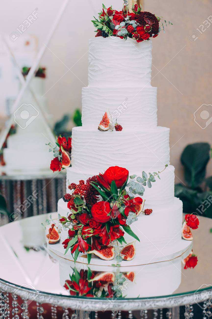 Wedding Cake With Red Fresh Flowers And Fresh Fruits Stock Photo ...