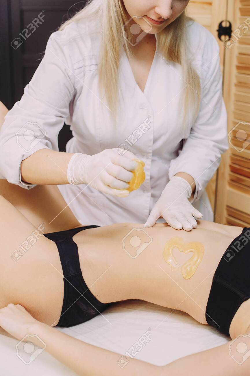 Hair removal at spa luxury studio. Woman legs wax with shugaring. Hot sugar. - 145336723